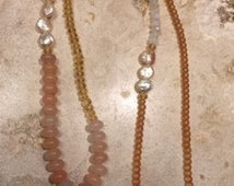 Necklace with pearls, pink opals, citrines, moonstones with diamond and pearl pendant