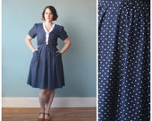 plus size dress / plus size navy polka dot belted dress / 1980s / XL