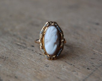 Vintage 10K angle skin coral cameo with seed pearl trim