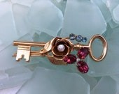 CAVIAR DREAMS Blue Topaz, Ruby and Diamond Colored Rhinestone and Faux Pearl Key Gold Tone Brooch - Etsy andersonhs