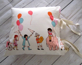 Baby cushion cover, pillow cover, Sarah Jane Children at Play fabric, nursery, with bows