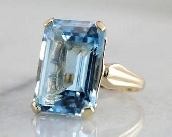 Bold Blue Beauty: Blue Topaz Statement Ring with Vintage Gold Mounting  K6ARCX-N