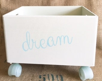crate toy box with wooden wheels