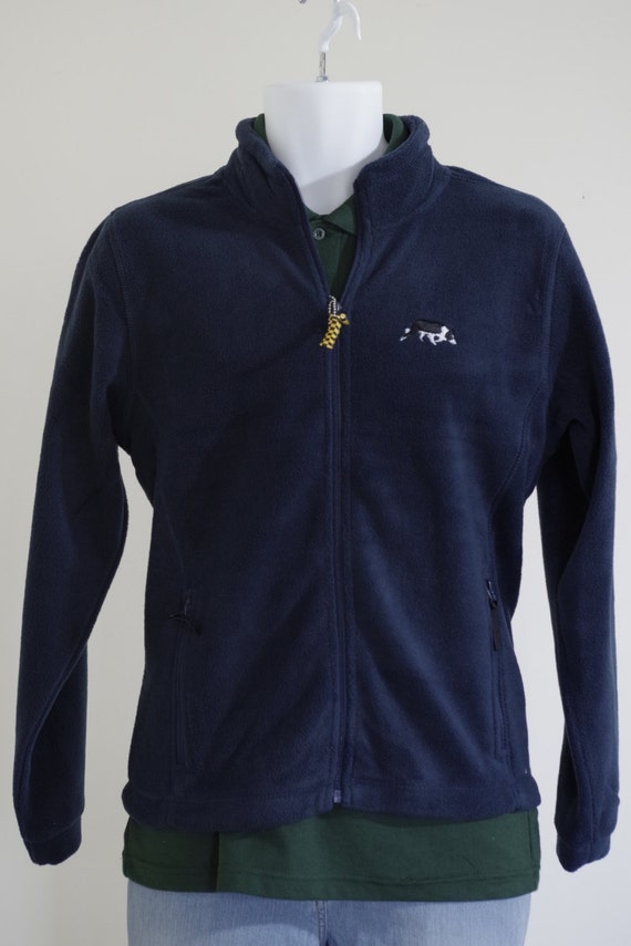 Ladies navy fleece jacket embroidered with a sheepdog border