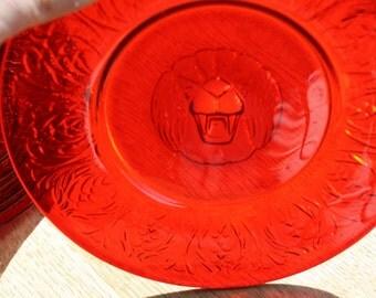 RARE Pukeberg Jules Venon Roaring Lion Head plates, set of 8, 1926-1929, Reijmyre Sweden, red/amber glass