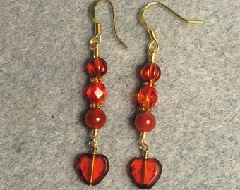 Translucent orange Czech glass heart bead dangle earrings adorned with orange Czech glass beads and orange agate beads.