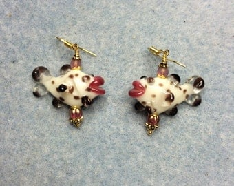 White, black and pink lampwork fish bead earrings adorned with pink Czech glass beads.