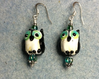 Teal and black lampwork owl bead earrings adorned with teal Czech glass beads.