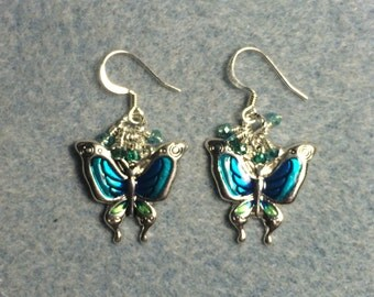 Turquoise enamel butterfly charm earrings adorned with tiny dangling turquoise Chinese crystal beads.