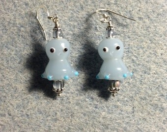 Light blue lampwork octopus bead earrings adorned with light blue Czech glass beads.