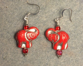 Red Czech glass elephant bead dangle earrings adorned with red Czech glass beads.