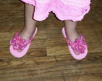 Crocheted rose flip flops