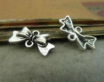 BULK 50 Bow Connector Charms Antique Silver Tone - DYS4340