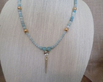 amazonite faceted beads,gold plated dimpled beads, and a gold tone spike