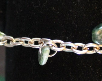 Silver bracelet with green stone chips