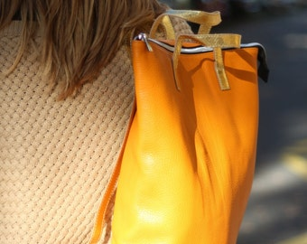 leather backpack orange