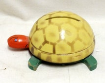"""Vintage Turtle bank 2 1/2"""" tall, projection 5 1/2"""" x 4"""", weight 4 oz. No key. Circa mid 1900's"""