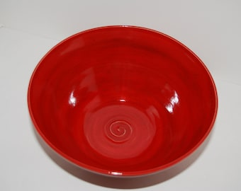 Red pottery bowl. Ceramic bowl.