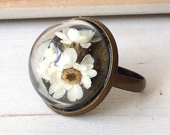 Ring with glass dome and flowers