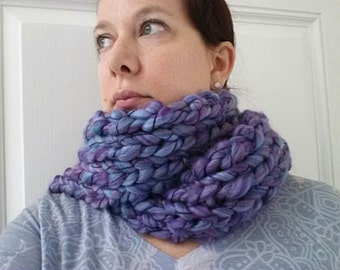 Purple hand knitted scarf.