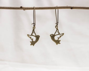 Earrings with a bird in bronze