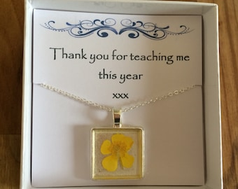 A thank you necklace - a real buttercup necklace with the message 'Thank you for teaching me this year'
