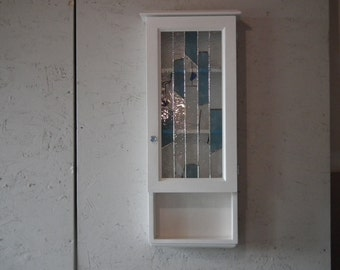Cabinet with door in stained glass and tablets