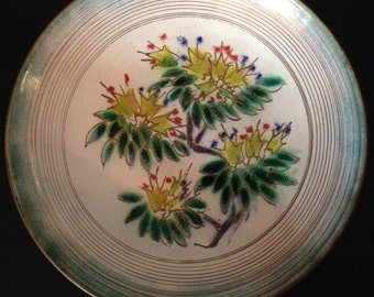 Large copper enameled bowl with asian style floral motif