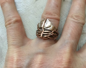 Silver wire copper ring, handmade uneven faith, overlapping materials, unique and artistic object. I'm not.
