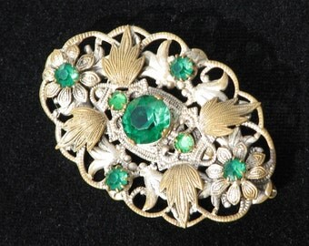 Beautiful Filigree Brooch inset with Green glass crystals