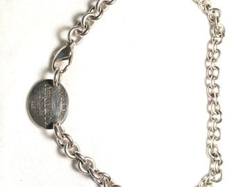 Please return to tiffany & CO New York 925 oval tag necklace