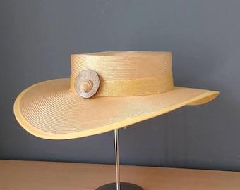 Yellow wide brim straw hat.