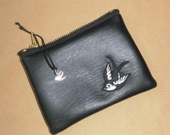Black vinyl purse with swallow