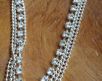 Anklet shiney silvertone tripple. They are gorgeous!  You can also wear it like a bracelet. not for small wrists I suppose.
