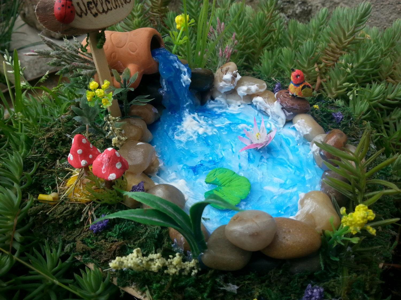 Fairies garden pond garden accessories river rock terrariums for How to make a mini garden