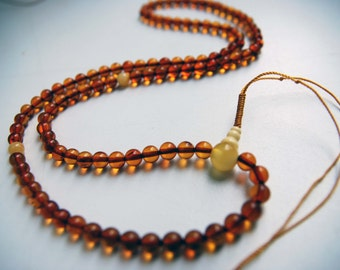 White stupa - 108 baltic amber mala (size Ø7 main colour 4)