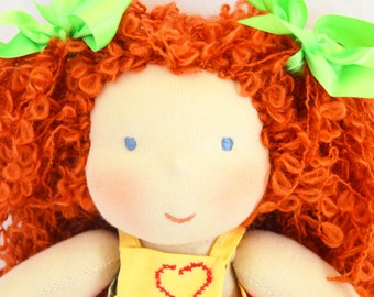 "Waldorf doll 11"" with light brown curly hair in rainbow romper"