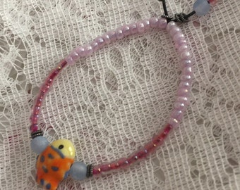 Whimsical Goldfish and Pink Glass Bead Stretch Bracelet