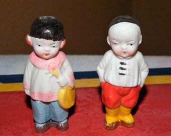 Vintage Asian boy and girl penny doll bisque set of 2