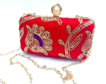 Evening box clutch in red made from silk fabric adorned with hand embroidered floral patterns and sequins