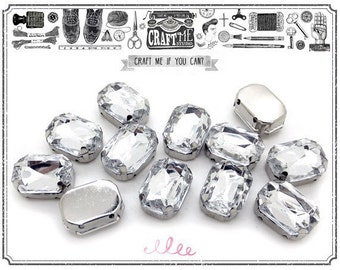 25PCS 10X14mm OCTAGON Sew On CLEAR Rhinestones crystal comes in a gold / silver colored prong setting.