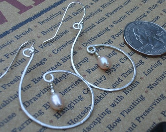 Hand hammered sterling silver with pearl drop