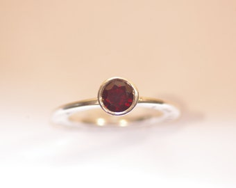 Ring with a garnet