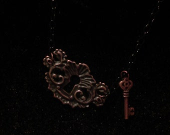 Bronze Key Hole with Key on a Chain