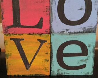 Beautiful hand painted wood block love sign