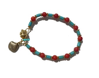 Bracelet with coral and turquoise beads.