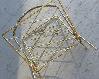 Vintage gold magazine rack record holder mid century modern hollywood regency