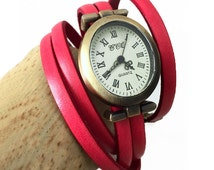 coral pink leather strap watch  oval dial wrist