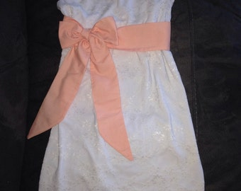 Lace dress with a sash