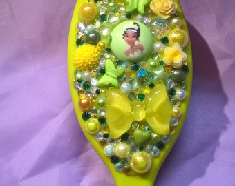 princess Tiana themed hair brush decorated with pearls,rhinestones,cabochons,butterflies,flowers and crystals comes in an organza bag